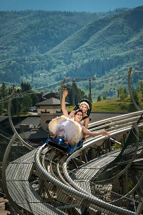 bride and bride riding roller coaster