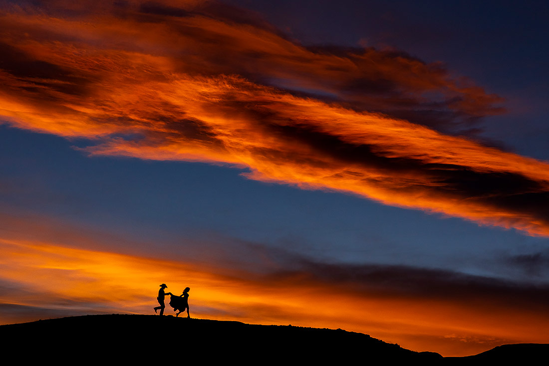 vibrant wedding photograph of couple silhouetted against the sunset