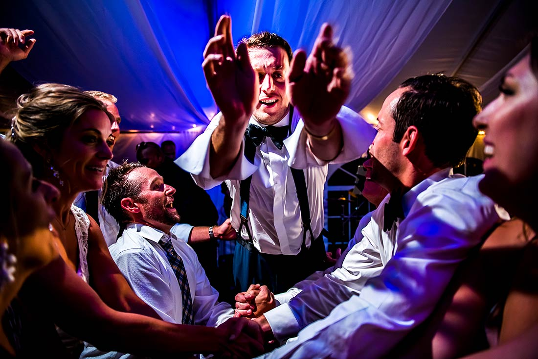 groom stage diving during dance party