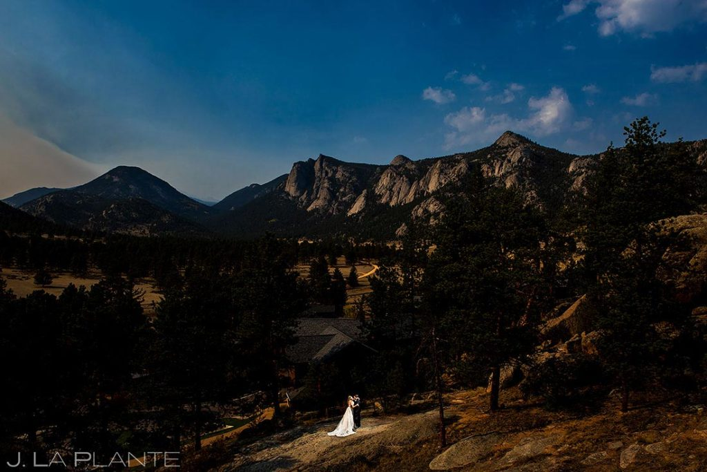 bride and groom hugging each other in the Rocky Mountains
