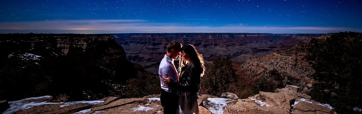 bride and groom to be posing under the stars