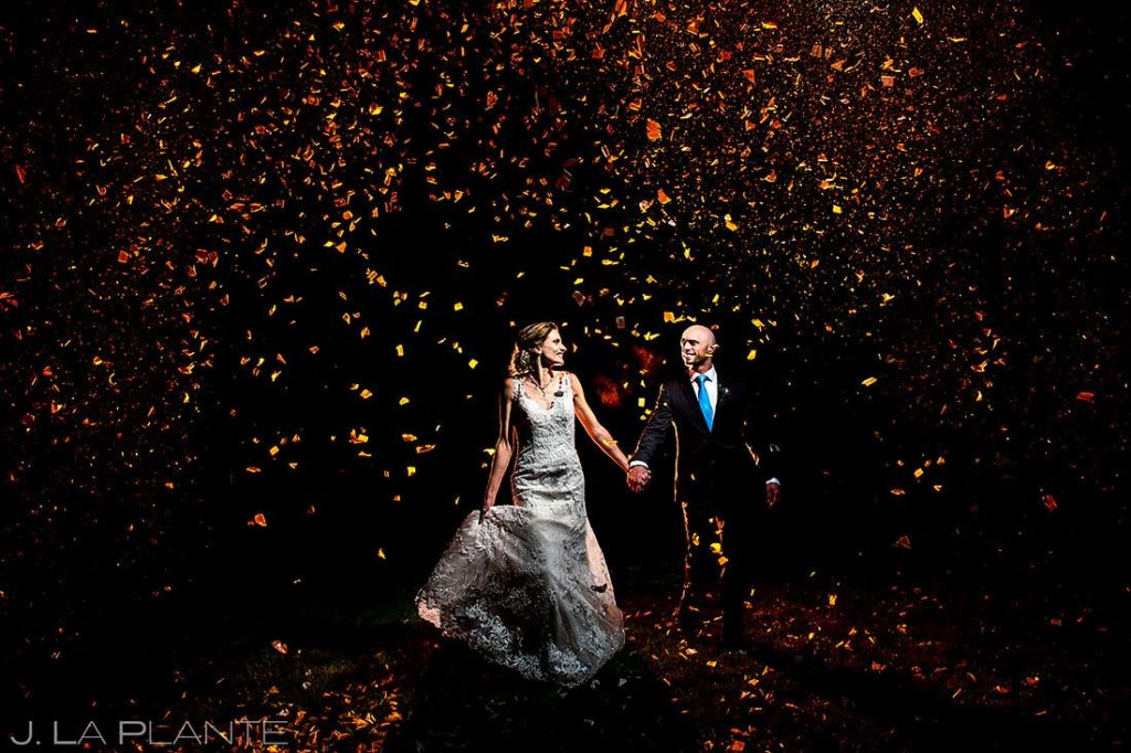 nighttime wedding photos of bride and groom with confetti in Boulder Colorado