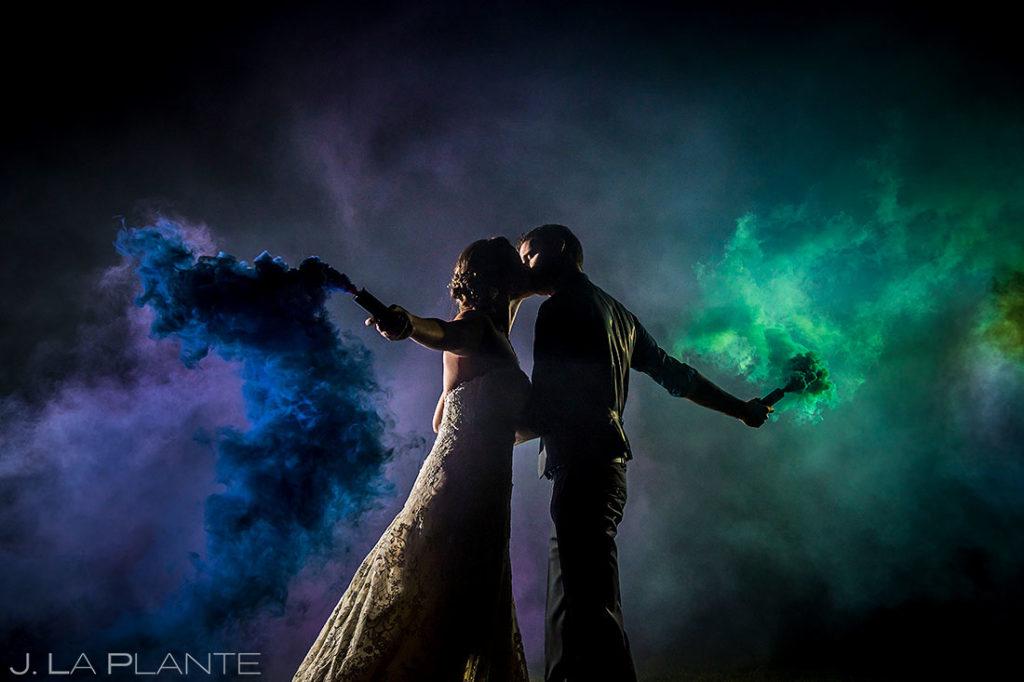 wedding portrait of bride and groom with smoke bombs
