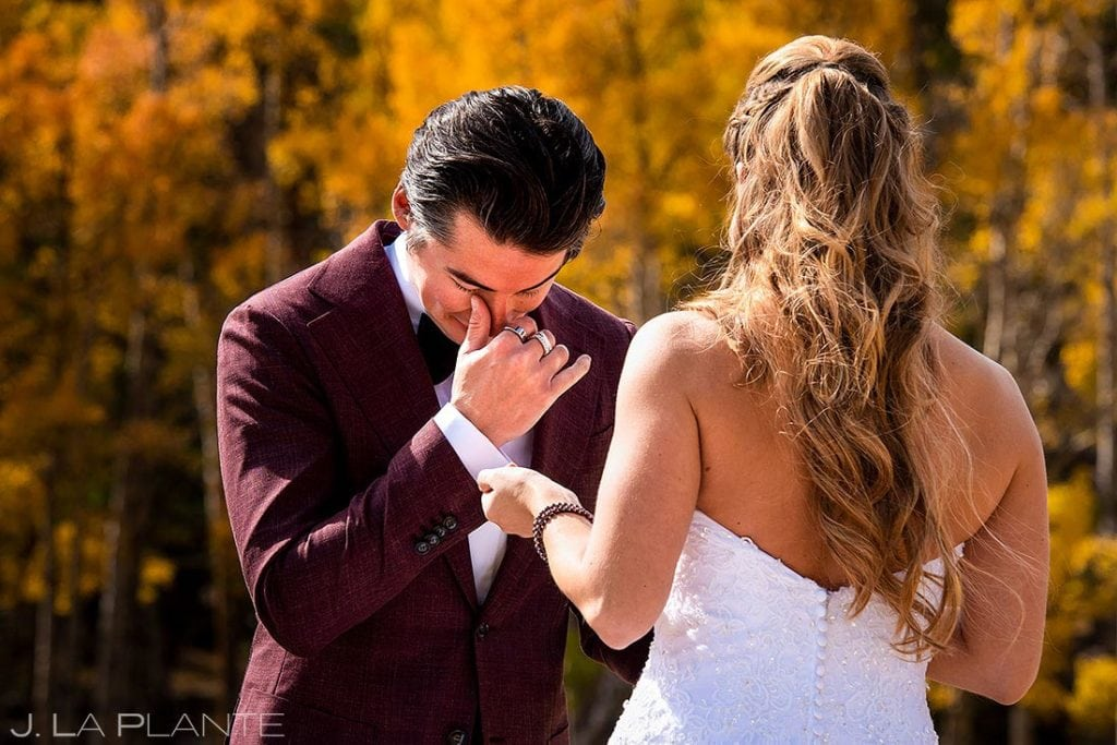 groom cyring during first look in Rocky Mountain National Park