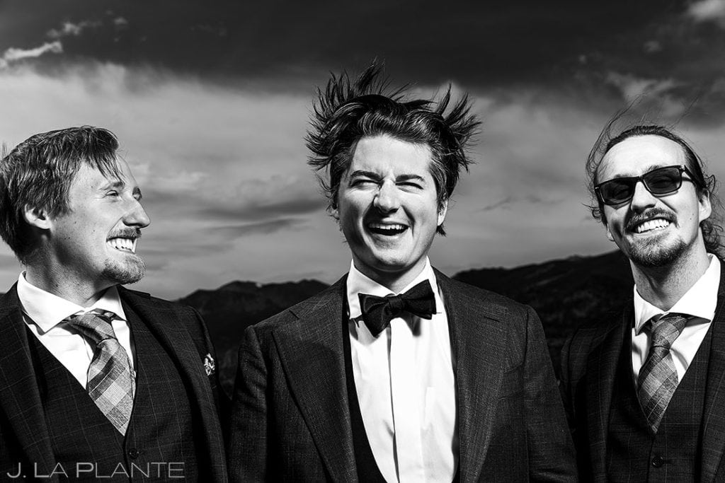 wedding photo outtakes groom's hair blowing in the wind