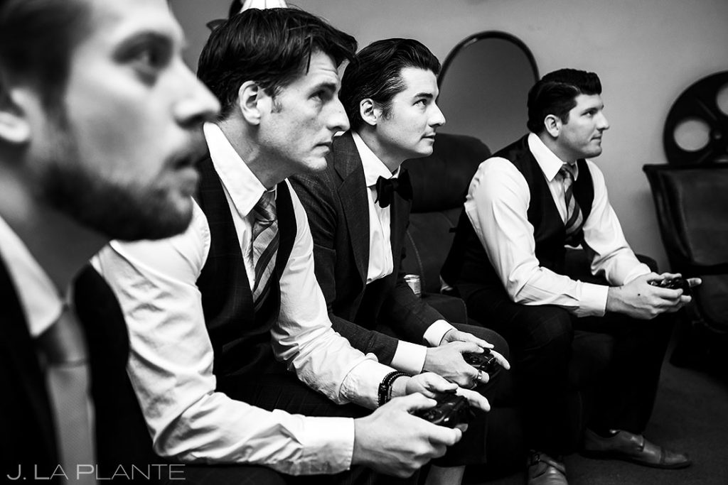 groomsmen playing video games before fall wedding at Della Terra