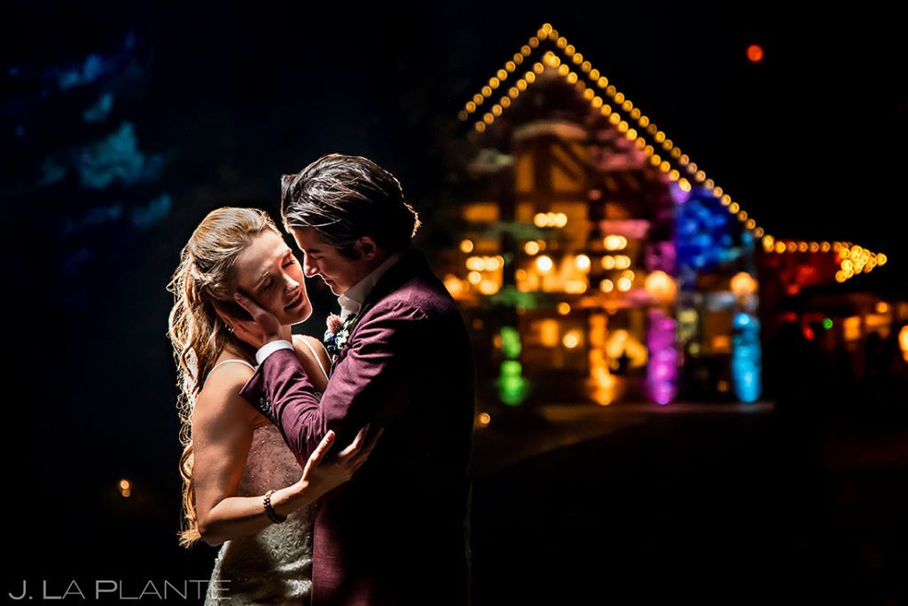 nighttime portrait of bride and groom at Della Terra