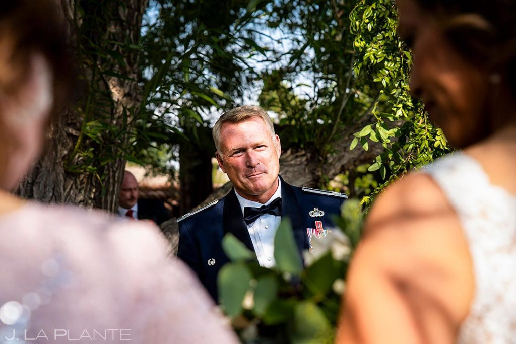 groom watching the bride walk down the aisle