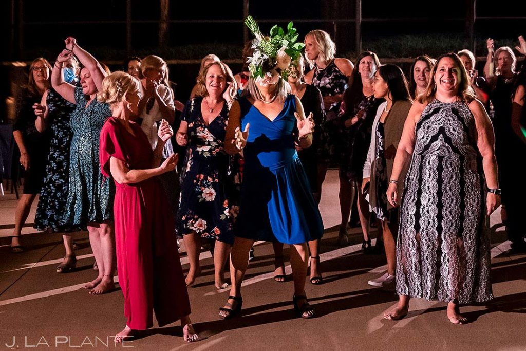 fall wedding at Spruce Mountain Ranch bouquet toss