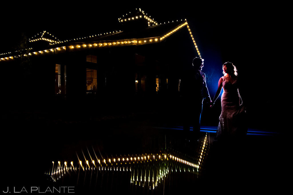 nighttime portrait of bride and groom