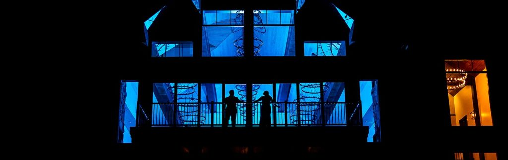silhouettes of bride and groom on balcony at Black Canyon Inn