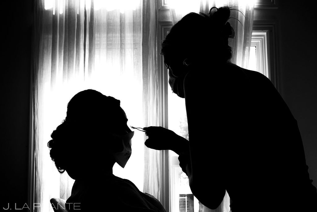 silhouette of Colorado makeup artist at work