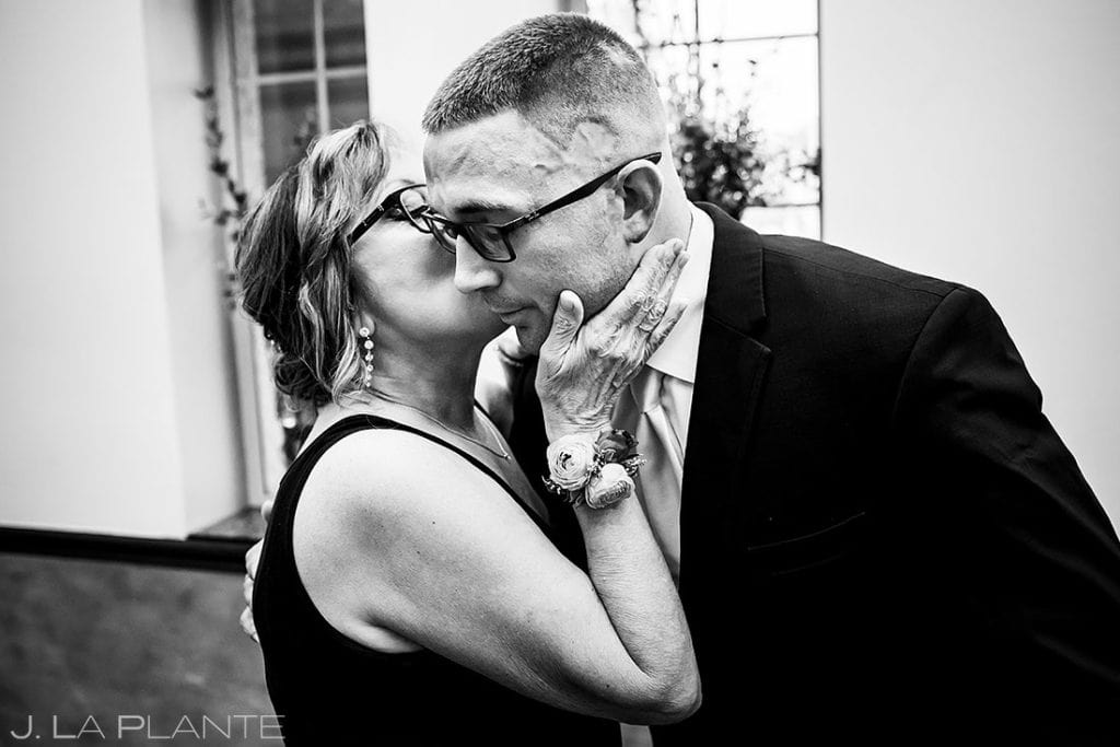 mother of the groom kissing her son