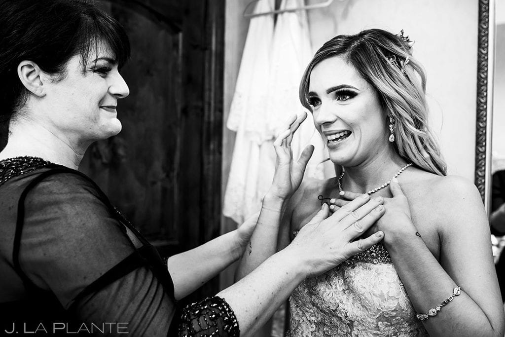 quiet moment between bride and mother before ceremony