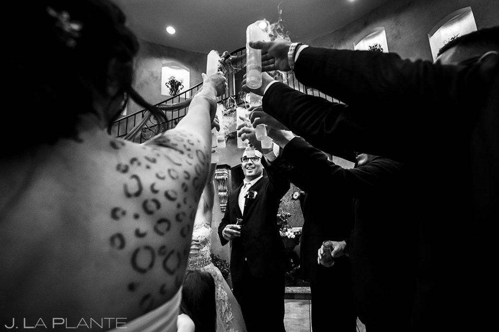 wedding party toasting with dry ice drinks