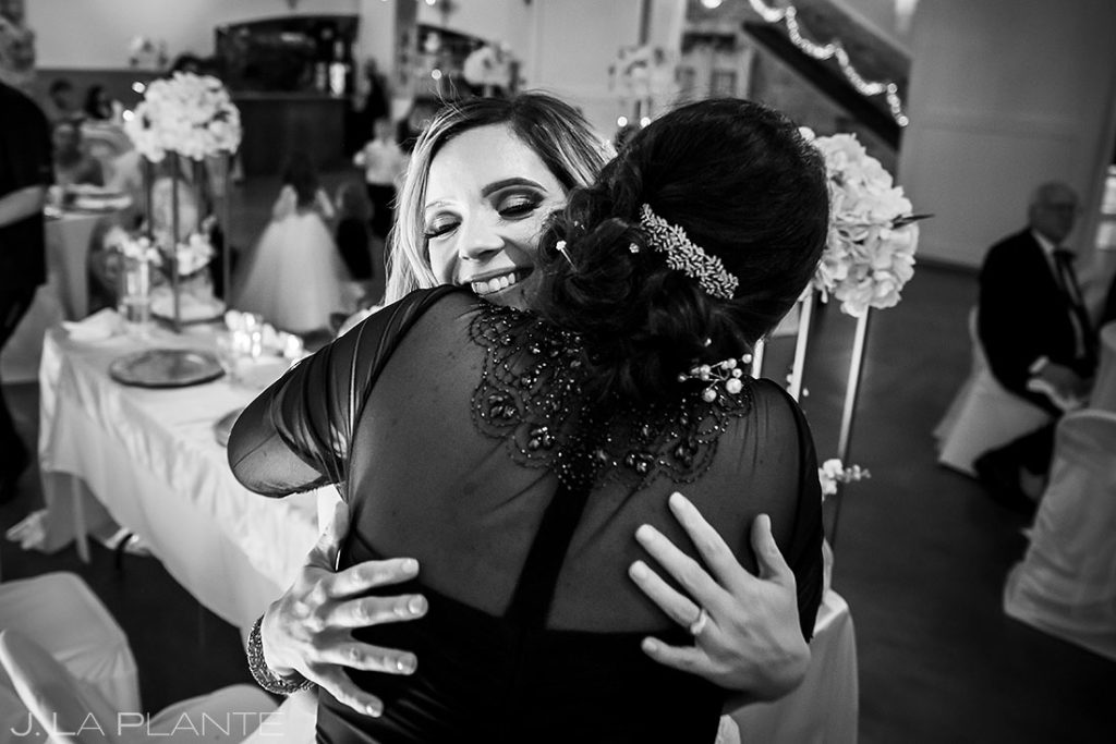 mother of the bride hugging her daughter