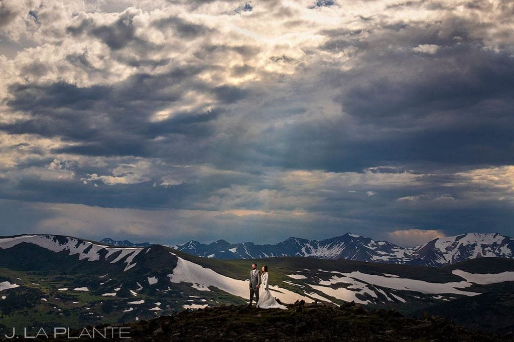 bride and groom hiking in Rocky Mountain National Park