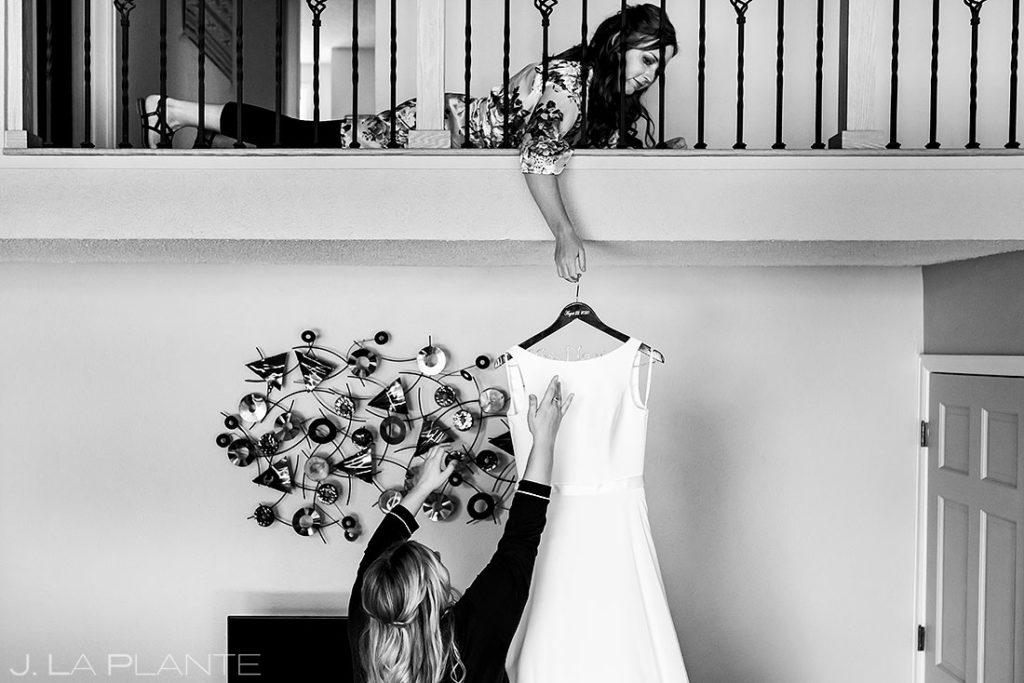 bridesmaids hanging up dress during summer wedding at Shupe Homestead