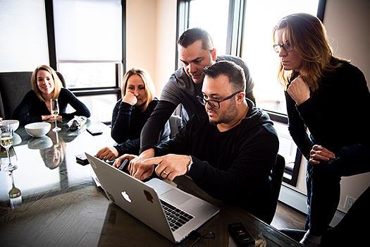photographers editing photos together
