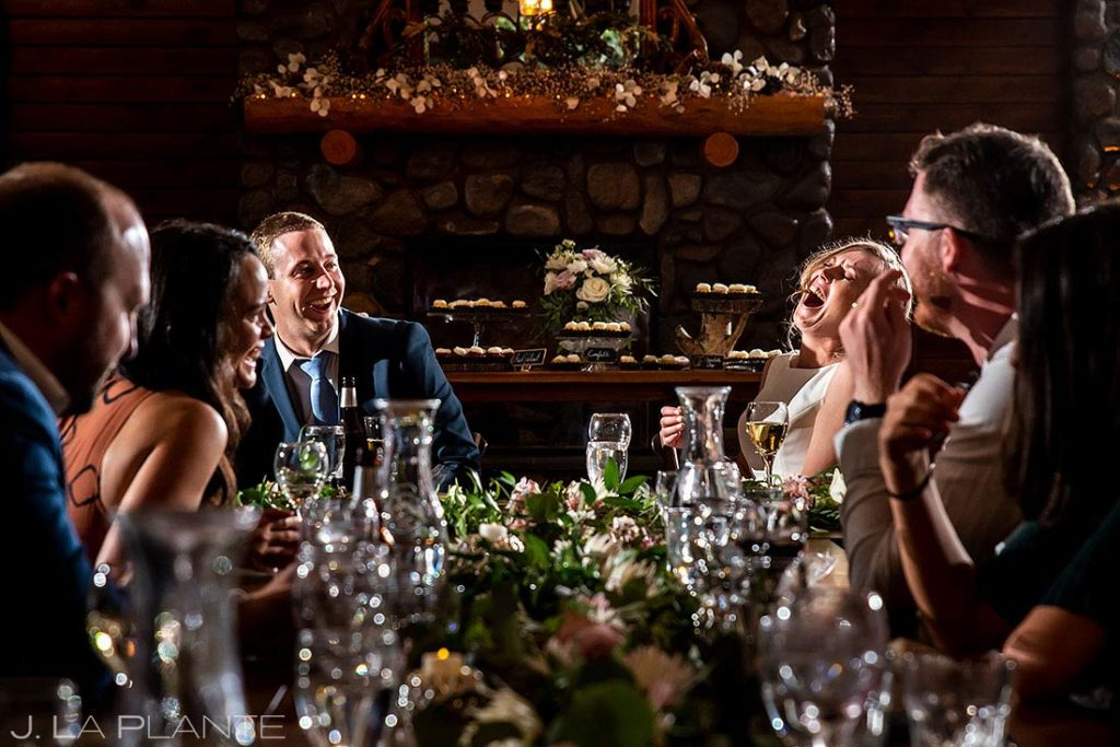 bride and groom laughing out loud during toasts