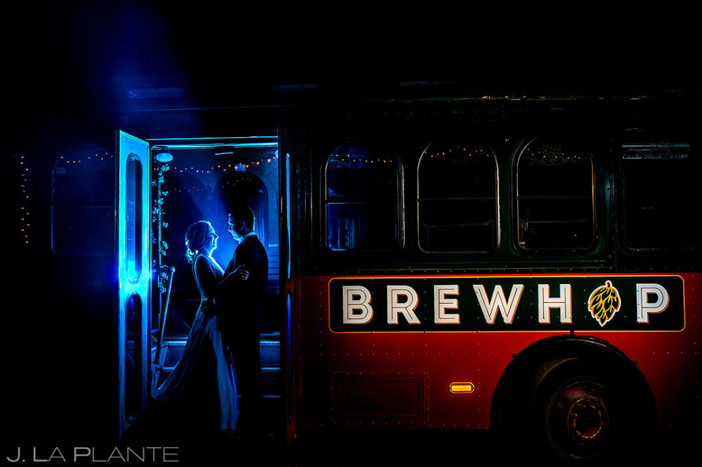 bride on groom riding trolley after summer wedding at Shupe Homestead