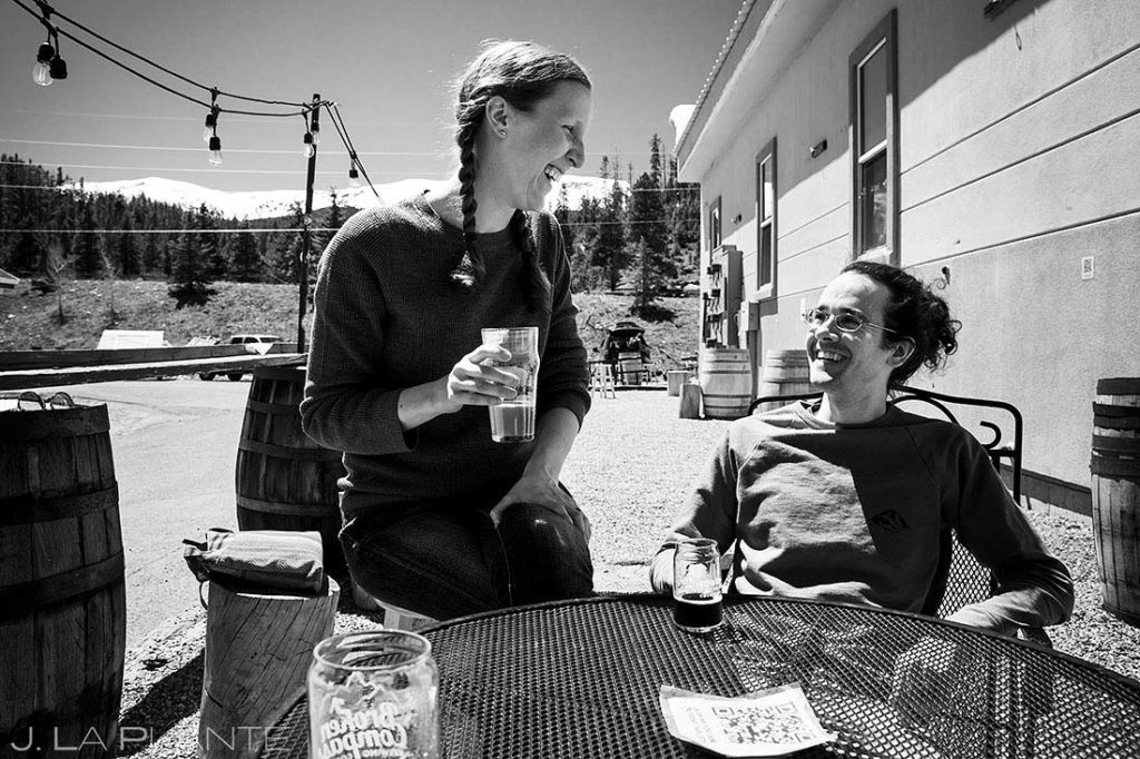 couple drinking at brewery before engagement session in Breckenridge, Colorado