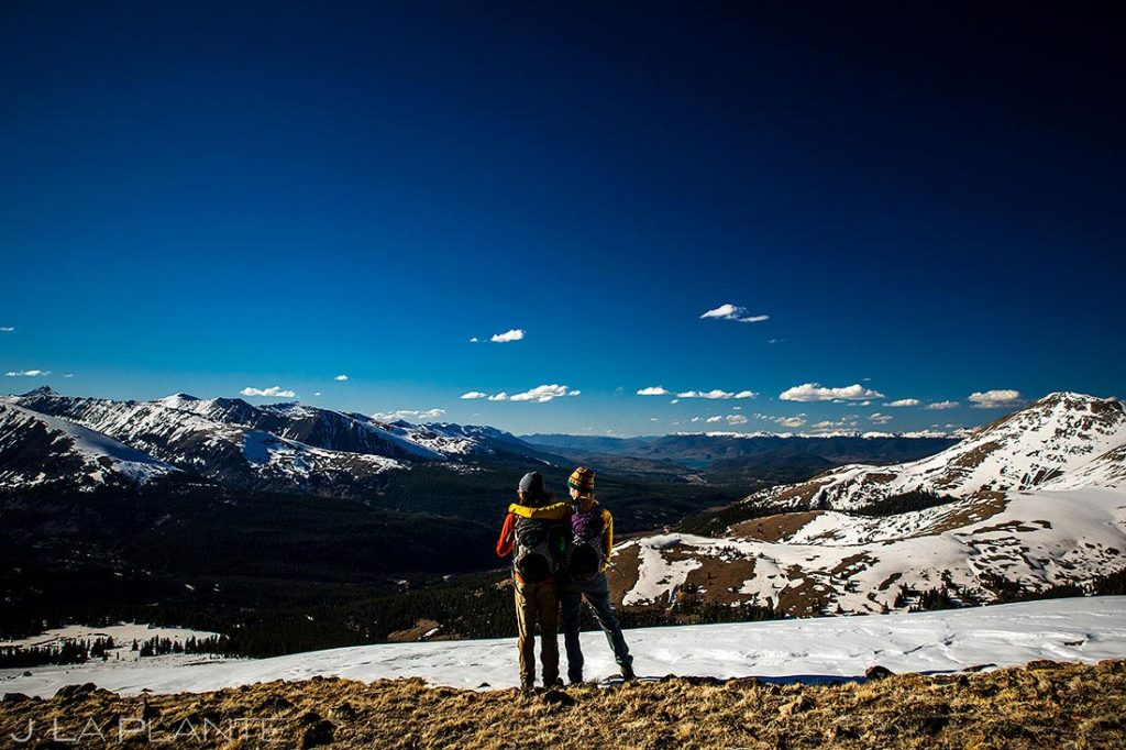 portrait of bride and groom to be in the Rocky Mountains