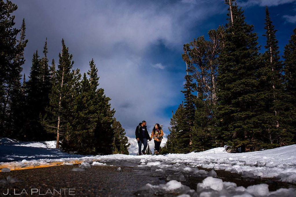 bride and groom hiking to elope at Brainard Lake Colorado