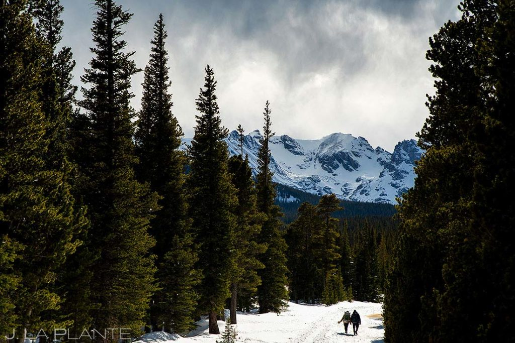 bride and groom hiking in the Rocky Mountains
