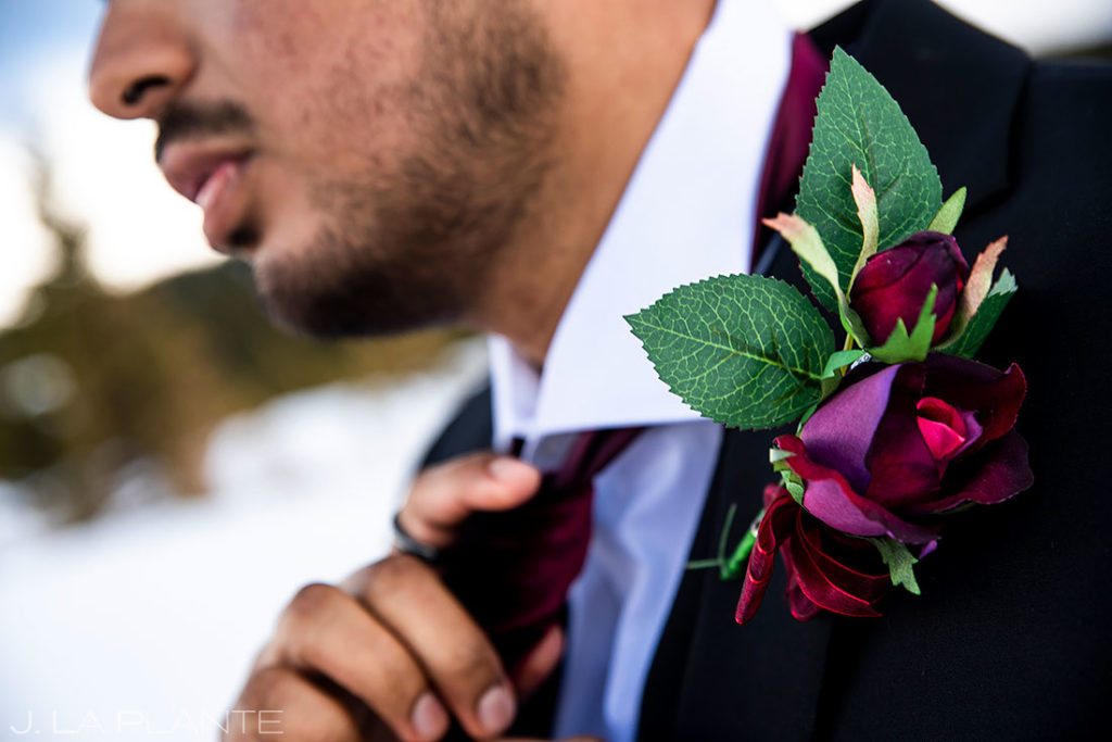 groom getting ready for Brainard Lake elopement