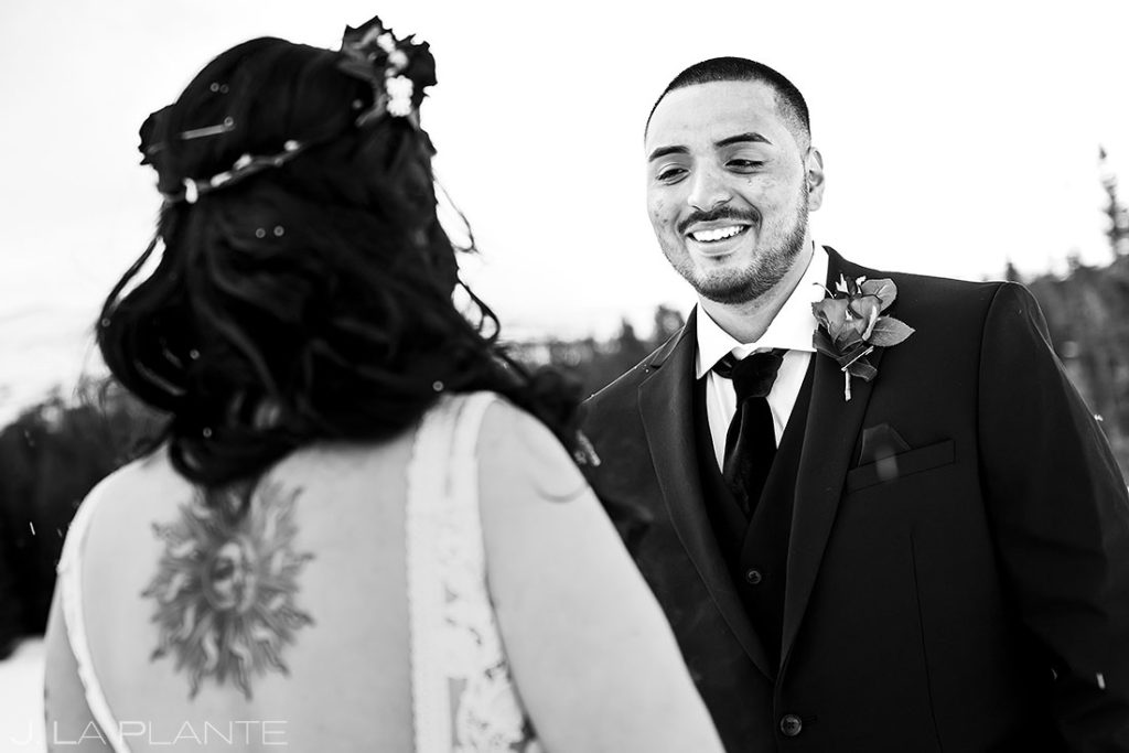 groom crying during elopement ceremony in the mountains