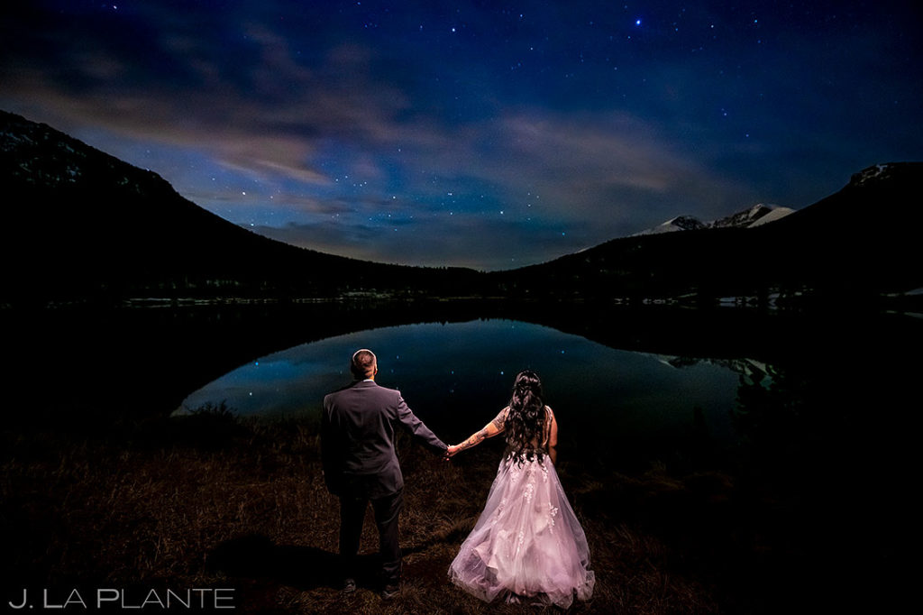 bride and groom under the stars during Brainard Lake elopement