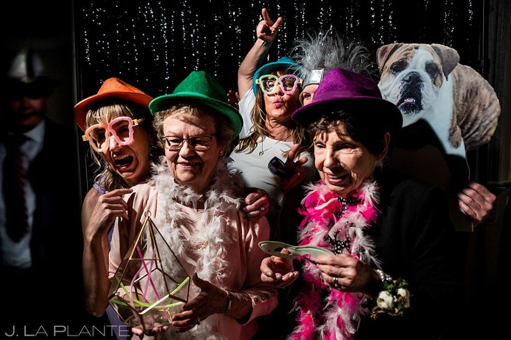 a photo booth will keep your guests happy while you're taking wedding photos with lawn games