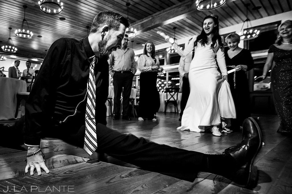 wedding guest doing the splits on the dance floor
