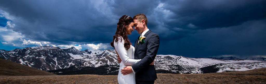 portrait of bride and groom in the mountains