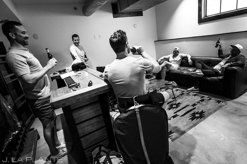 groomsmen drinking beer before wedding