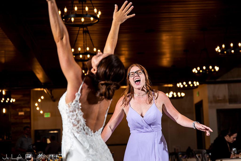 spring wedding at Black Canyon Inn bride dancing with bridesmaid