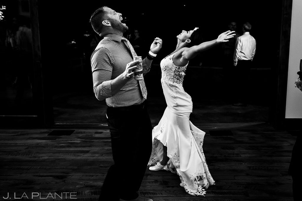 bride dancing with groomsman during reception