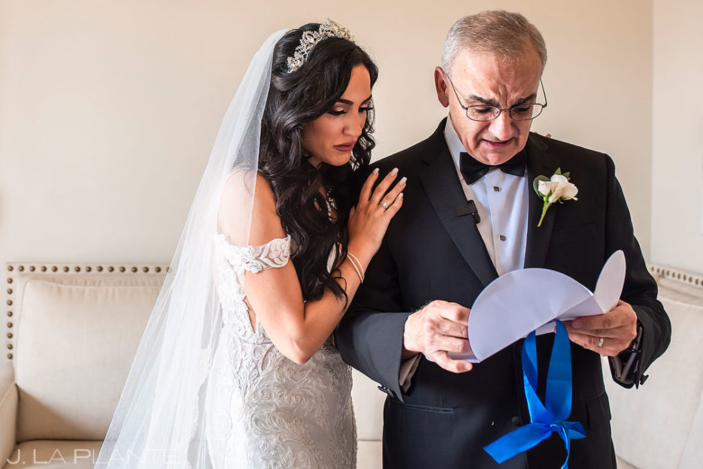 bride reading a letter with her dad before wedding ceremony