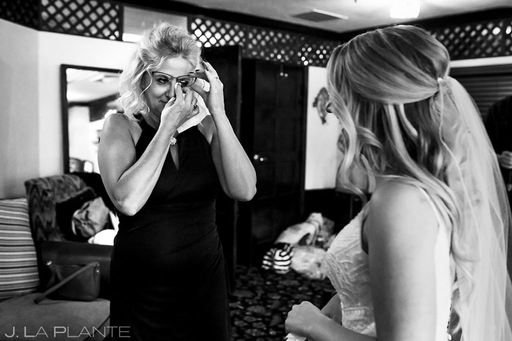 mother of the bride crying before ceremony