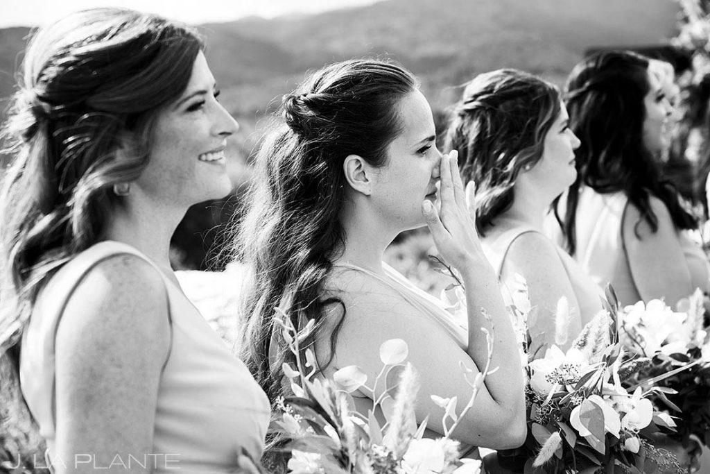 bridesmaid crying during wedding ceremony