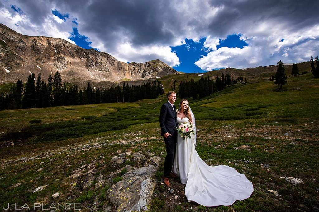 portrait of bride and groom in wedding attire in the mountains
