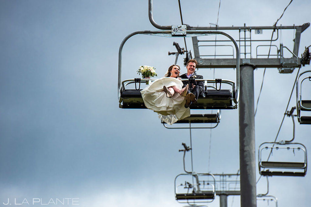 bride and groom riding chairlift to Arapahoe Basin wedding