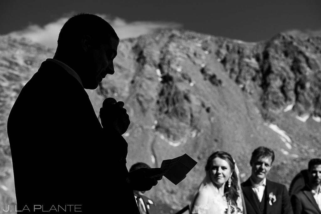 brother of the groom giving a reading during wedding ceremony