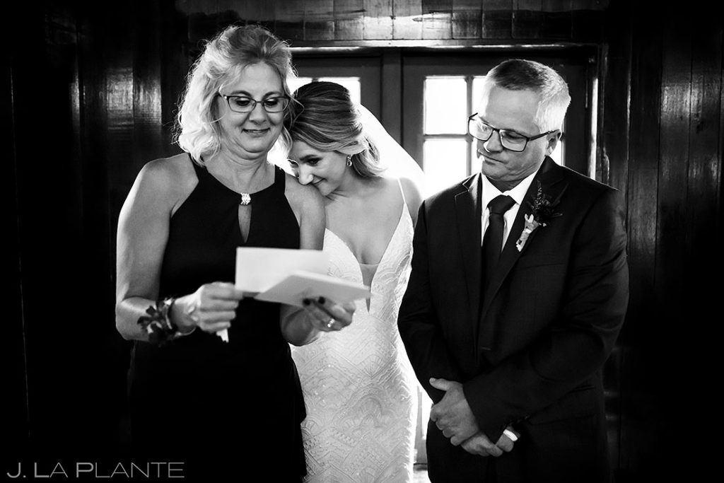 quiet moment with bride and her parents before ceremony