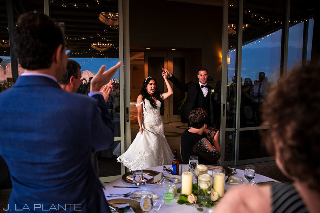 bride and groom entering the wedding reception venue