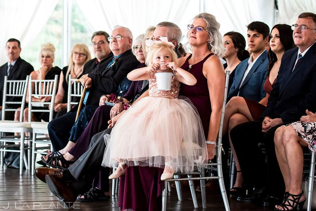 flower girl being funny during wedding ceremony