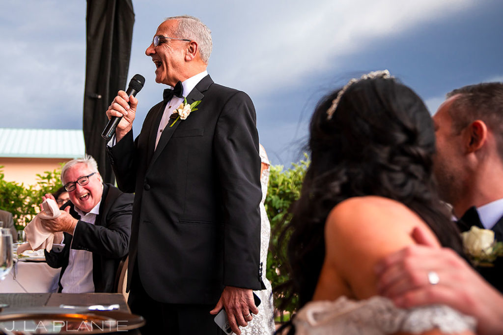 father of the bride giving toast before dinner