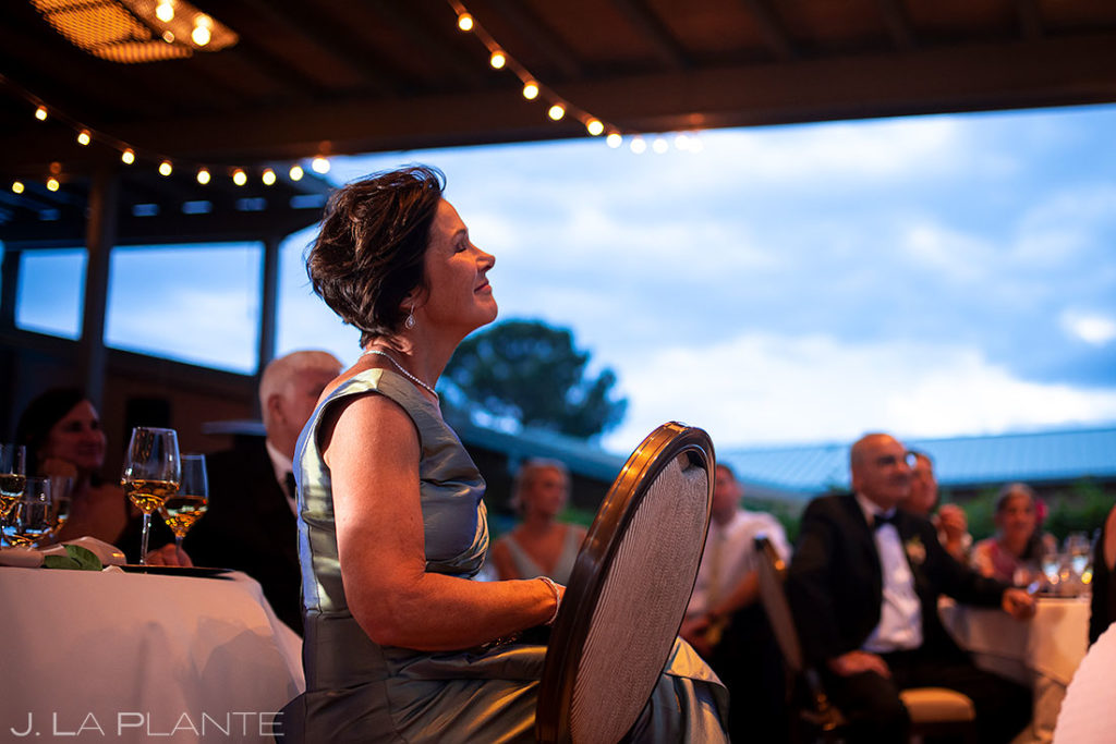 mother of the groom watching the toasts