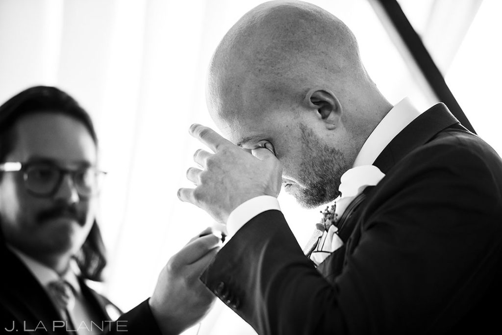 groom crying during vows at Denver wedding